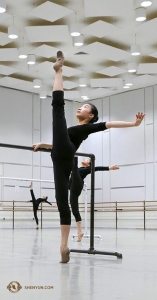 Dancer Cecilia Wang holds her leg at 180 degrees in the open space of the practice room. (Photo by Rachael Bastick)