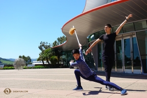 Dancers Leo Yin and Bill Xiong get into character before one of two shows in San Luis Obispo. (Photo by Jeff Chuang)