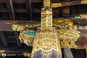 The bright colored and intricate detailing on the interior support beams in the castle. (Photo by Andrew Fung)