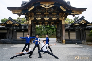 Dancers from the Shen Yun International Company pose in front of one of five gates at Nijo Castle. (Photo by Andrew Fung)