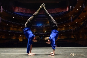 It's time to prepare for the performance. Dancers Johnny Cao and Allen Li help each other to balance their handstands on the stage of Conjunto de Artes Theater in Guadalajara, Mexico, where we are scheduled to hold four sold-out performances. (Photo by Edwin Fu)