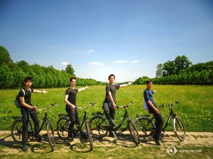 What do dancers do on their day off? Get some exercise of course. Bike riding through the gardens at Versaille are Jack Han, Peter Kruger, Henry Hong, and Felix Sun (L to R). After adding one extra performance due to popular demand, we are scheduled for eight performances while in Paris. (Photo by Tony Zhao)