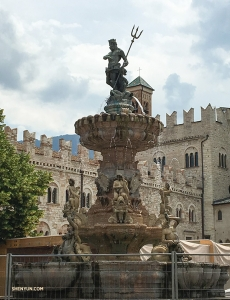 In the center of the Piazza del Duomo, in Italy, the Fountain of Neptune stands. The Roman god of the sea, with his trident, watches over the bustling activity of Trento's main square.