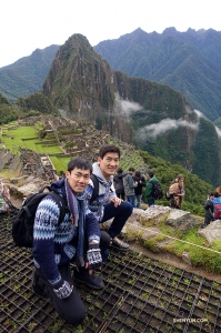 After hiking to the top, Felix and Alex pause for a shot.