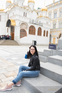 Sitting on the steps in Cathedral Square.
