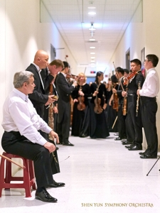 Backstage, the Symphony members are almost ready to enter the concert hall.