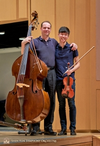 Principal Bassist Juraj Kukan and violinist Austin Zhong happily pose for the camera.