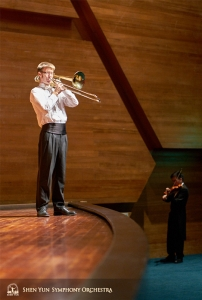 Practicing on stage and off: Principal Trombonist Alistair Crawford and violinist Davin Ma.