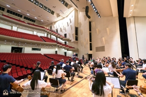 The Symphony gathers for rehearsal before their final Taiwan concert at Tainan Cultural Center.