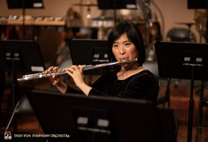 Before the concert, Principal Flutist Chia-jung Lee warms up with long tones.