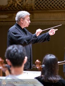 Conductor Milen Nachev fine-tuning a piece.