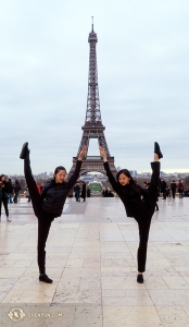 Dancers Kexin Li (L) and Olivia Zhang augment the Eiffel Tower. (Photo by Tiffany Yu)
