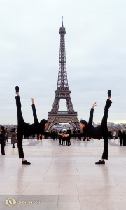 We're so excited to be in Paris! Flanking the 130-year-old Eiffel Tower are dancers Olivia Zhang and Elsie Shi (L to R). (Photo by percussionist Tiffany Yu)