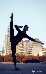 Meanwhile in Austin, TX, dancer Lily Wang touches her toes to the sky with the cityscape as a backdrop. (Photo by dancer Michelle Wu)
