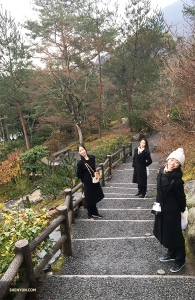On the way back, dancers (from left) Liz Lu, Justina Wang, and Hazel Yu decide to take a shortcut through the Sogenchi Garden. (Photo by Betty Wang)