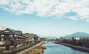 Heading out for another day of exploring, dancer Michelle Wu captures the river scenery adjacent to Kyoto's Gion Station.