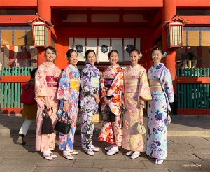 Great minds think alike! Two groups of kimono-wearing dancers bump into each other and gather for a group shot.