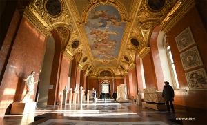 One of the Louvre's many ornate hallways and ceiling art. (Photo by Annie Li)