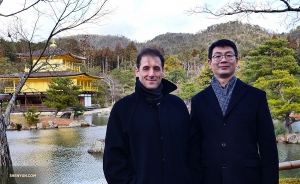 Emcee Leeshai Lemish (left) and stage manager Gregory Xu with the ancient Buddhist temple.