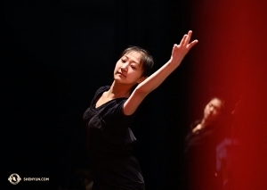 Olivia Chang, another dancer with Shen Yun International Company, warms up before one of two performances in Liverpool.
