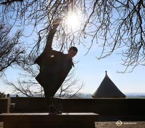 Dancer Scott Xu kicks toward the sun. (Photo by Nick Zhao)