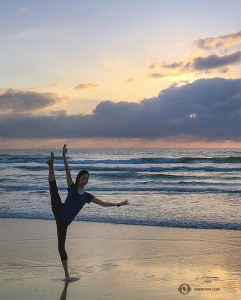 Dancer Betty Wang complements the tranquil sunrise.