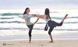 Dancers Yoriya Kikukawa (left) and Yuwen Lin playfully pose on the beach. After performing in six cities across Australia, the next stop is—South Korea!