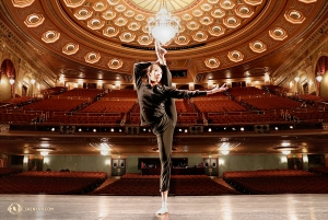 Dancer Yinian Chen warming up before one of three performances at the Benedum Center, which was originally built as a movie palace in 1928. (Photo by Kaidi Wu)