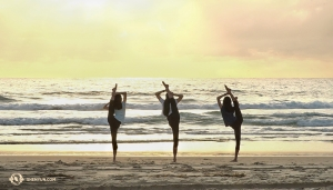 It's the last day of the Aussie leg of tour and dancers get up early to do one final stretch while watching the sunrise on the beach. (Photo by projectionist Regina Dong)