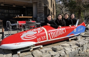 Dancers (from left) Diana Teng, Eva Su, Sophia Chang, and Hannah Jao huddle in a bobsled. (Photo by dancer Yuxuan Liu)