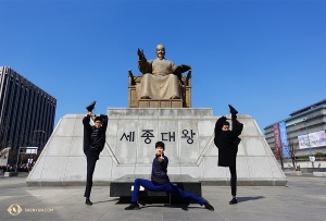 Dancers (from left) Antony Kuo, Jungsu Lee, and Jun Liang pose in front of the King Sejong statue at the Gwanghwamun Plaza in Seoul. (Photo by dancer Jeff Chuang)