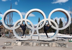 The 2010 Winter Olympics were held right here in Whistler! Dancers Hannah Jao (left) and Sophia Chang use the Olympic rings to aid their stretching. (Photo by Eva Su)
