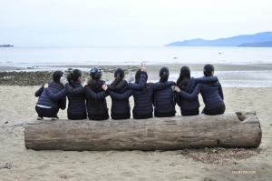 Better than a typical park bench, this huge log can fit eight dancers! (Photo by dancer Diana Teng)