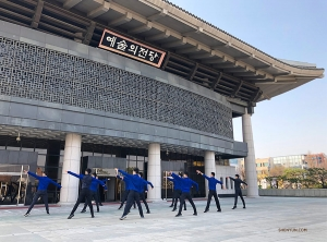 Due to limited space inside the Cheongju Art Center, rehearsal is moved to the plaza outside. Dancers synchronize their moves in front of the theater's reflective glass doors—they make pretty good mirrors!