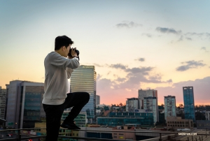 Principal Dancer William Li tries to capture the sun setting from his balcony. (Photo by dancer Daniel Jiang)
