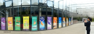 Like a beautiful rainbow, the colorful array of Shen Yun posters on display at Marion Oliver McCaw Hall are captured by Principal Dancer Elsie Shi.