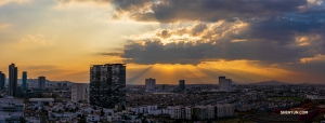 A stunning panoramic photo of the densely populated city at the end of the day.