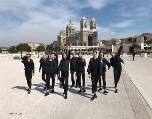 With the Marseille Cathedral in the background, dancers have fun taking a stroll.