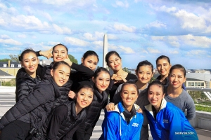 Taken on their final day in Washington, D.C, Shen Yun North America Company dancers pose between two shows, with the Washington Monument in the background.