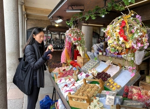 Principal Dancer Michelle Lian checks out the local handmade crafts at London's Covent Garden market.