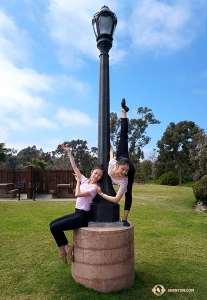 A lamp post comes in handy for dancers Daoyong Zheng (left) and Angela Xiao.