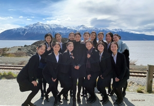 Dancers use the impressive Alaskan landscape as background for a group photo. It's still a little chilly.