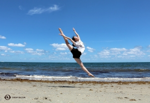 Dancer Wendy Ba on the sandy shoreline at Dania Beach in Fort Lauderdale.