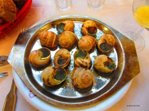 The brave sample the famous French dish escargot (aka snails).