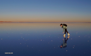 Wading through the salt flats at sunset.