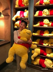 Melody Qin finds a new friend at Pooh Corner.