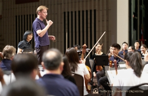 A rehearsal with conductor Dmitry Russu