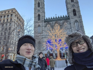 Ben Chen takes a selfie with fellow dancer Jun Liang and a well-lit holiday tree.