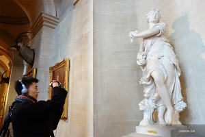 Dancer Joe Chang snaps a photo of one of the many pieces of artwork on display.