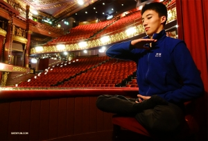 Dancer Joe Chang finds a quiet balcony to do some pre-performance meditation at the Palace Theatre in Manchester, U.K.
